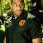 Men's black short sleeved shirt with Ninelivez logo