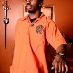 Men's short sleeved orange short with ninelivez logo